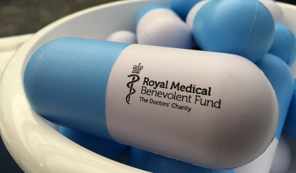 RMBF-branded stress ball in the shape of a capsule