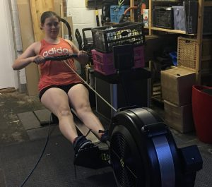 Fundraiser Mel rowing on her rowing machine