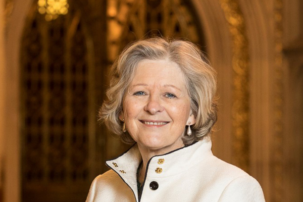 Professor Shiela the Baroness Hollins wearing a white jacket